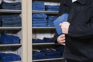 jeans being stolen by a shoplifter