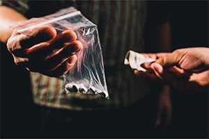 Dealer selling illegal drugs