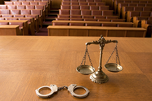 Symbol of law and justice in the empty courtroom