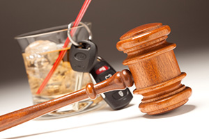 Car keys with gavel and alcoholic drink