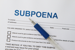 Close up picture of Subpoena with pen